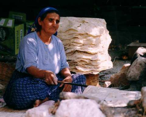 villager turning the bread